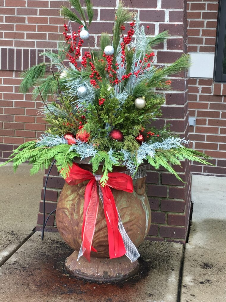 Winter planter with greens and ornaments